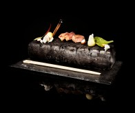 boar, apple, cinnamon, hazelnuts, malto hazelnutoil & wild herbs. the warm log spend organic heat, the lighted cinnamon gives the dish a smokey cinnamon smell, at the same time as the waiters serve the dish the guest hear the sound of a bonfire. (chopsticks)