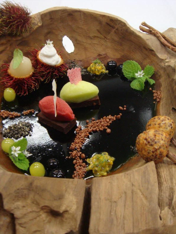 small pond: woodruf jelly,fruits,chocolate sponge cake,wild staberry sorbet,green apple sorbet,chocolate pop rocks,licorice & baked sweet sesame praline.