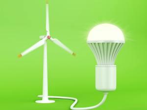 Wind turbine and glowing light bulb