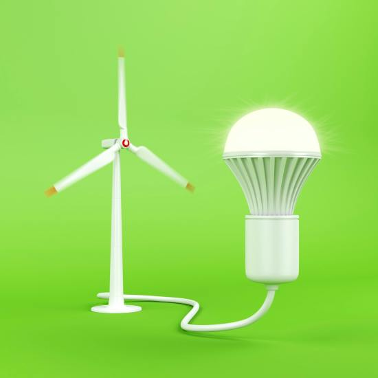 Wind turbine and glowing light bulb