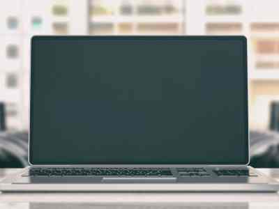 Laptop on an office desk. 3d illustration