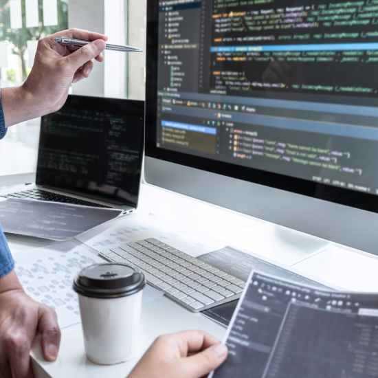 Team of developer programmer working on project in software development computer in IT company