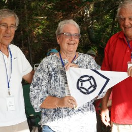 Vice-Commodore Chuck Mead presenting the 25-year member burgee to Bill and Clare Walker of MV Rangatira