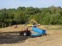 Moving the top soil around for consistency.