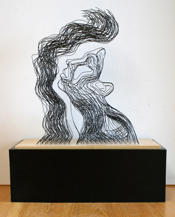 """And Light Fell on Her Face Through Heavy Darkness"" wire sculpture"