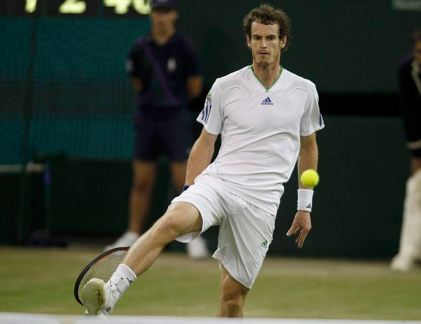Andy Murray of Britain hits a return, with a shot between his legs, to Ivan Ljubicic of Croatia at the Wimbledon tennis championships in London June 24, 2011. REUTERS/Stefan Wermuth (BRITAIN - Tags: SPORT TENNIS)
