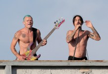 Flea, Anthony Kiedis, Chad Smith The Red Hot Chili Peppers give a free concert from a rooftop in Venice Beach while filming a music video. The Beatles-esque performance featured Anthony Kiedis, Flea, Josh Klinghoffer, and Chad Smith. (July 30, 2011 - Source: PacificCoastNews.com)