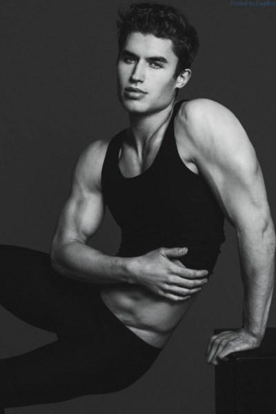 Black and white image of male model Brandon Lipchik sitting