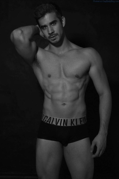 Muscled male model Eduardo Rivera standing waring only black underwear