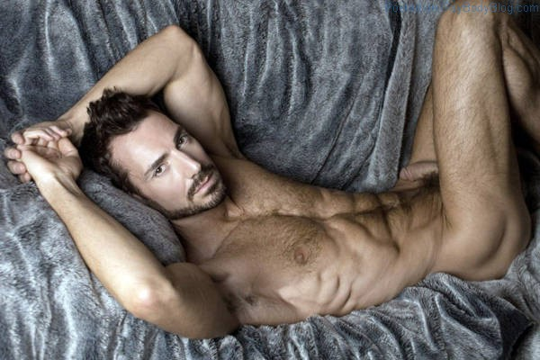 Hairy daddy model Bryan Slater laying on a couch naked