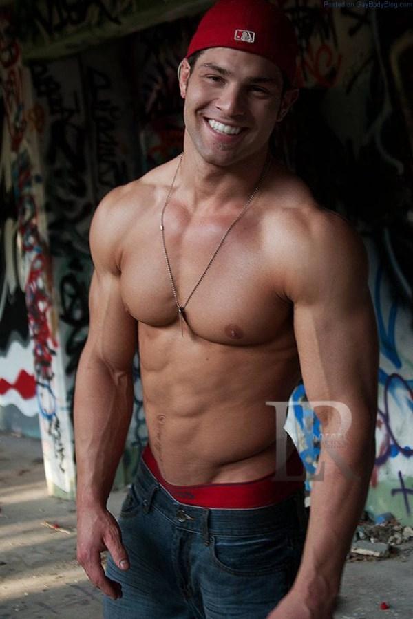 Markus Ricci shirtless and smiling