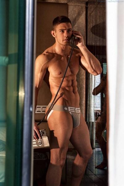Kirill Dowidoff on the phone wearing underwear