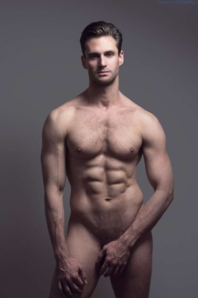 Nicholas Cunningham naked and hiding his cock and balls