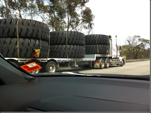 Over taking a truck carrying 6 huge tyres