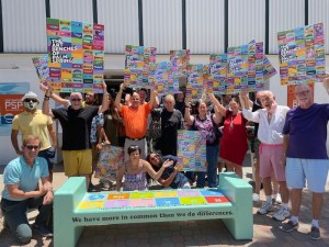 Art Bench Project Artists Holding Up Poster