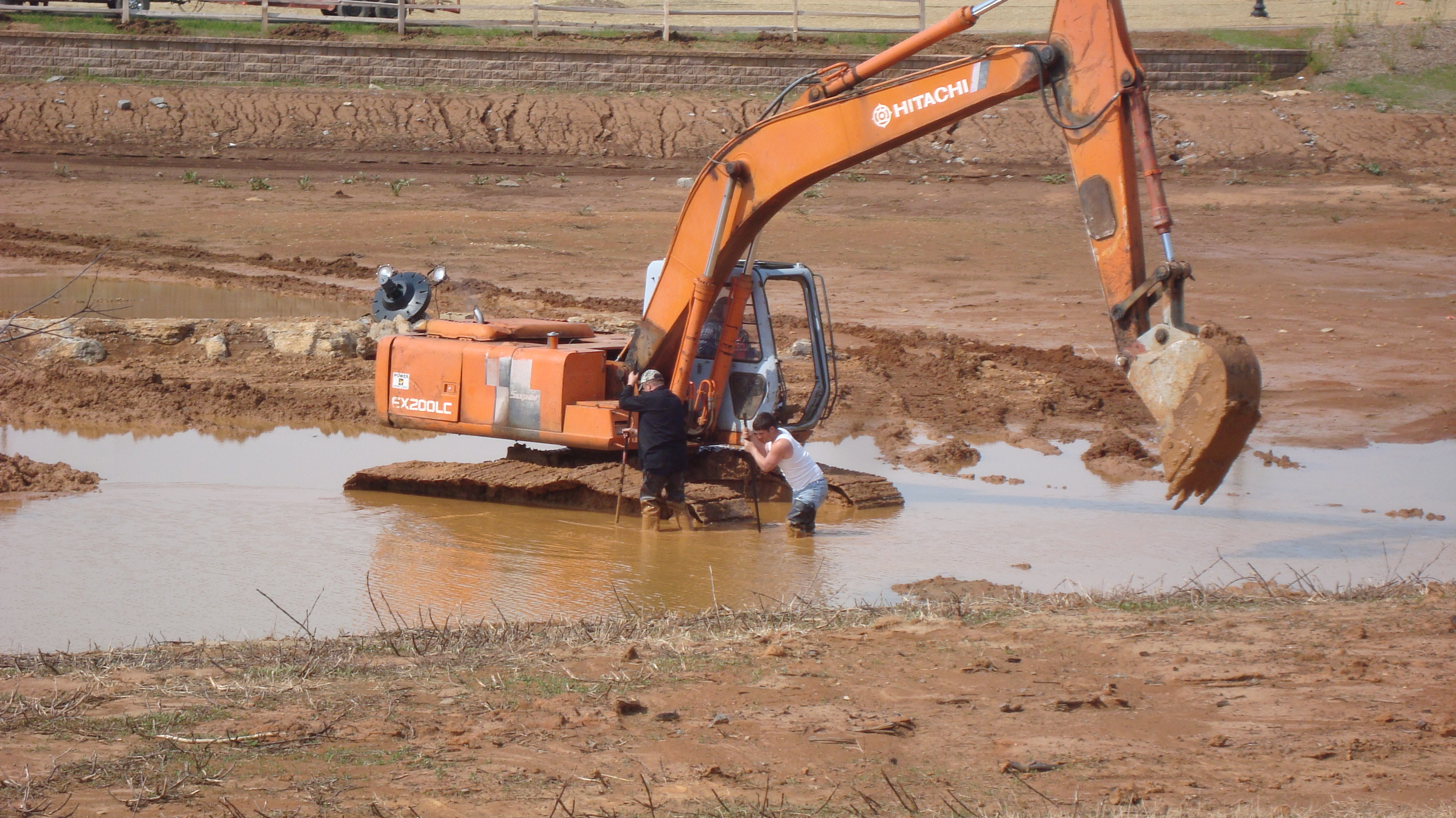 heavy equipment at the water feature on the new section by the hospital