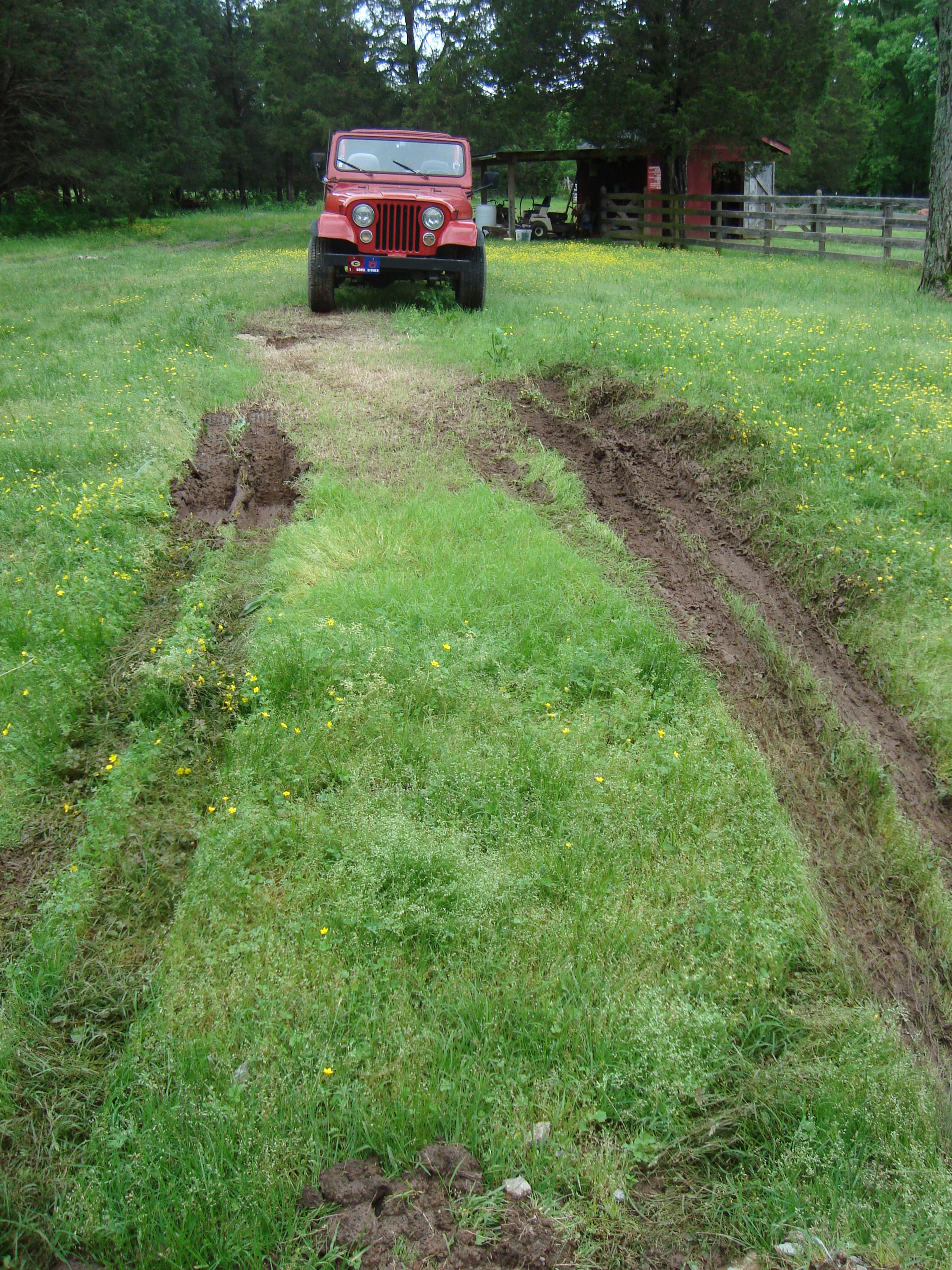ruts where trailer tires were; jeep in 4-wheel drive low, pushing the camper....