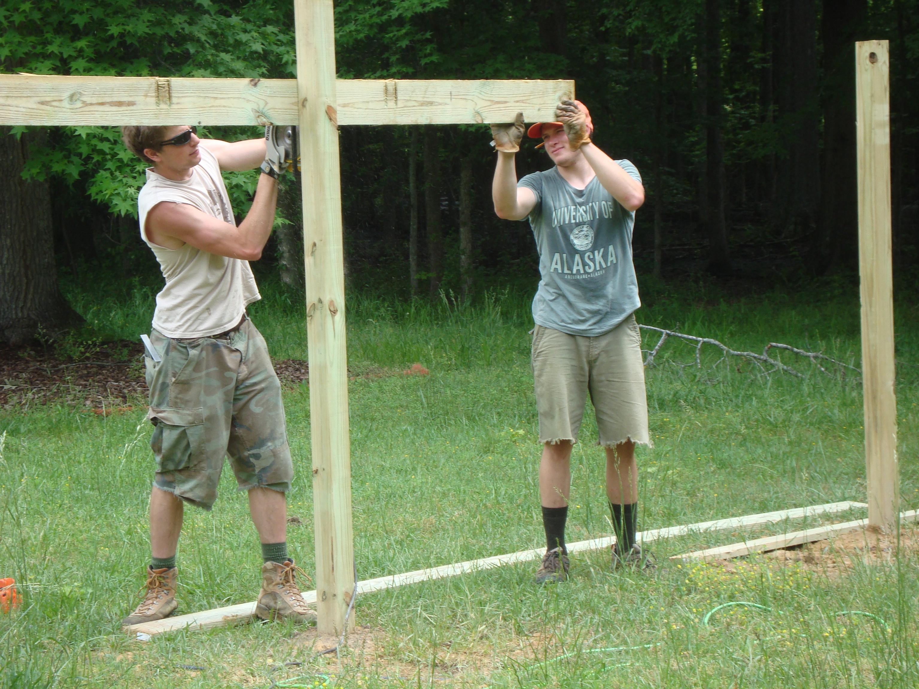 my boys fence-building for Uncle Eric