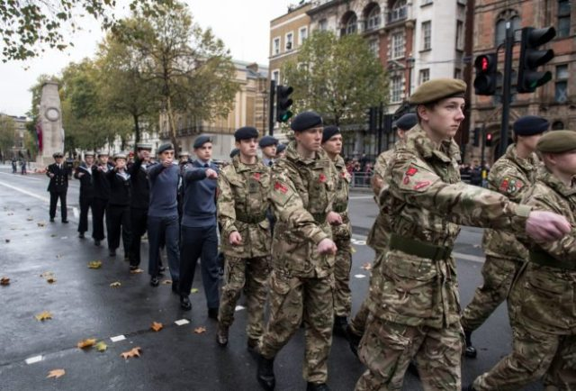 Army, navy and RAF cadets march away after the Western Front Association's (WFA) annual service of remembrance on Armistice Day, at the Cenotaph in central London on November 11, 2017. / AFP PHOTO / CHRIS J RATCLIFFE (Photo credit should read CHRIS J RATCLIFFE/AFP/Getty Images)