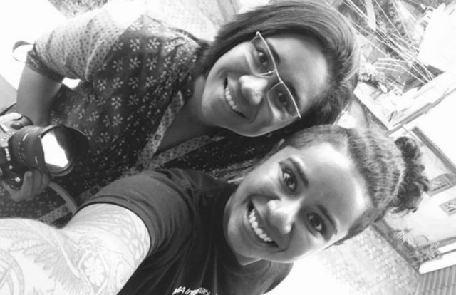 Black and white selfie of two women