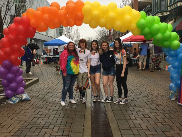Friends under a rainbow arch in Columbus