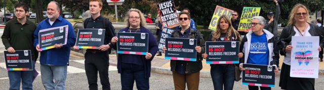 Activist hold signs at supreme court rally