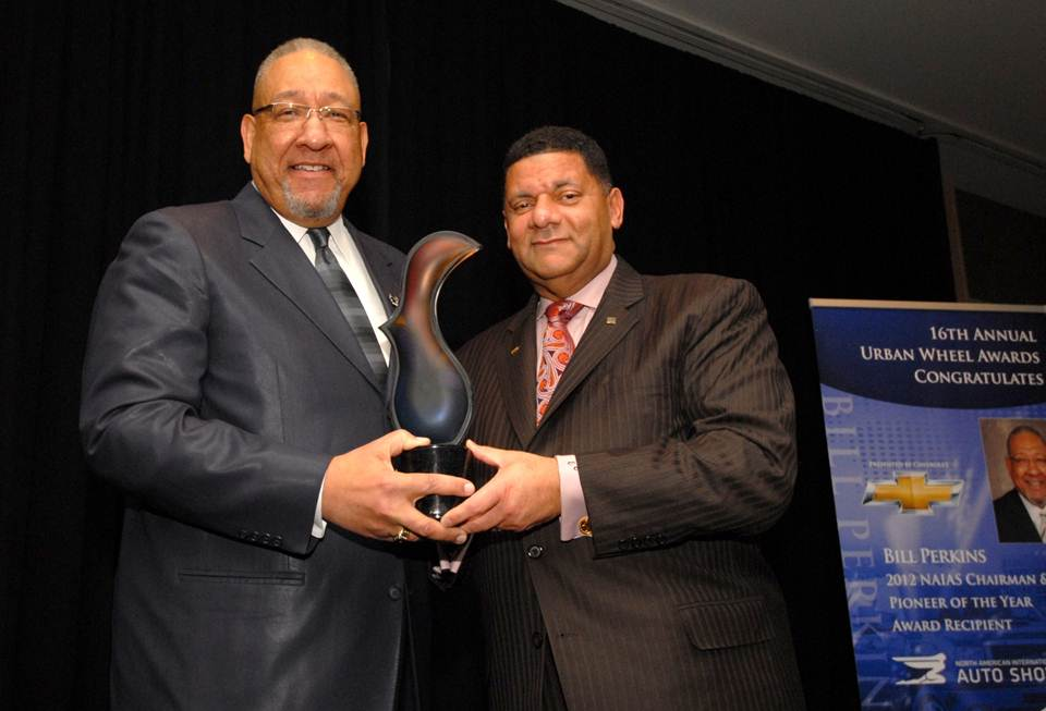 Left to right: Chevrolet Dealer Bill Perkins poses with his Urban Wheels Pioneer of the Year Award and General Motors Vice President Diversity Eric Peterson