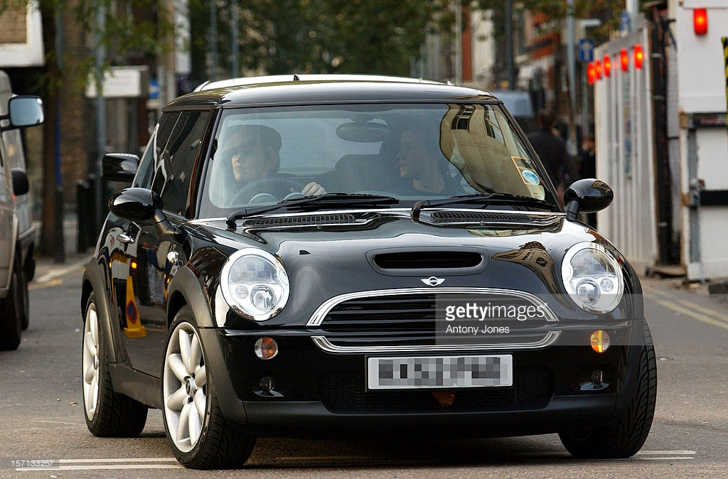 Madonna driving her 2002 Mini Cooper S in the UK