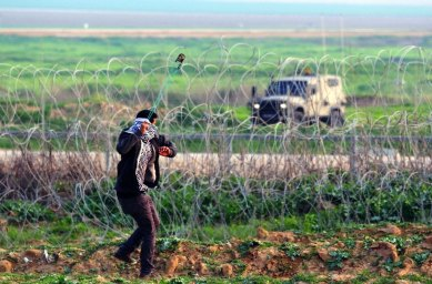 Palestinian slingshot and the Israeli military on the Gaza/Israel border
