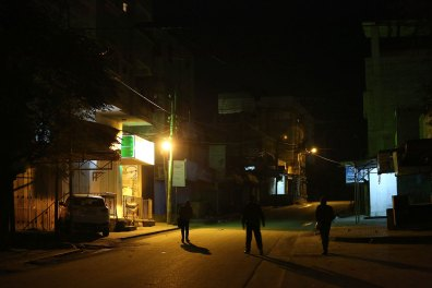 Street at night with three men