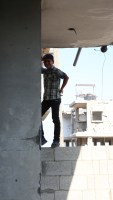 Boy leans against a wall