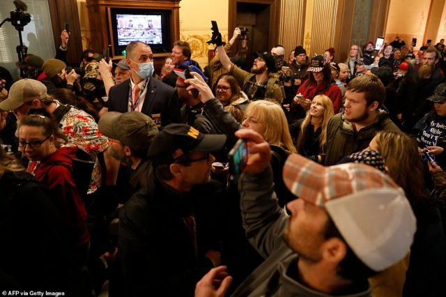 27856096-8275171-Protesters_tried_to_enter_the_Michigan_House_of_Representatives_-a-112_1588283688550-640x426