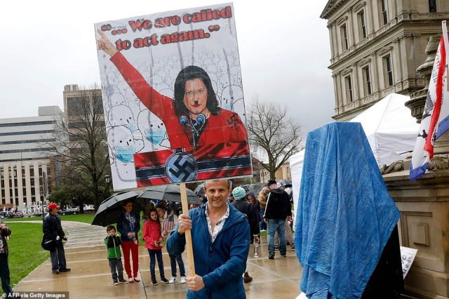 27856100-8275171-One_demonstrator_held_a_sign_that_has_Gov_Whitmer_depicted_as_Ad-a-123_1588283688828-640x426