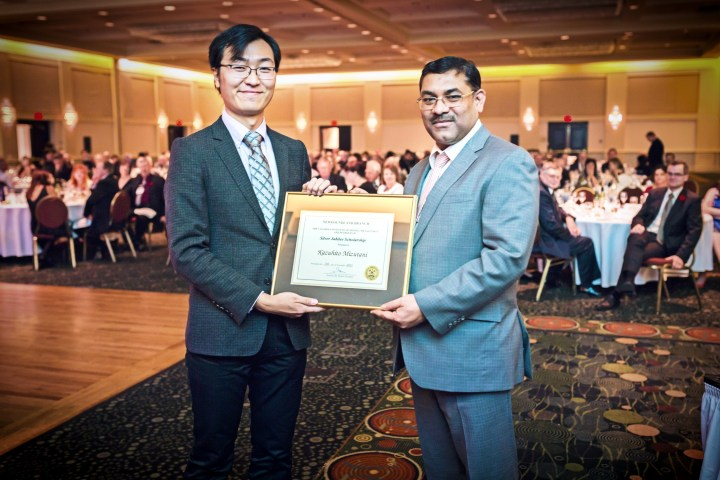 From left, Kazuhito Mizutani and Praveen Jha, president, Canadian Institute of Mining, Metallurgy and Petroleum, Newfoundland Branch.