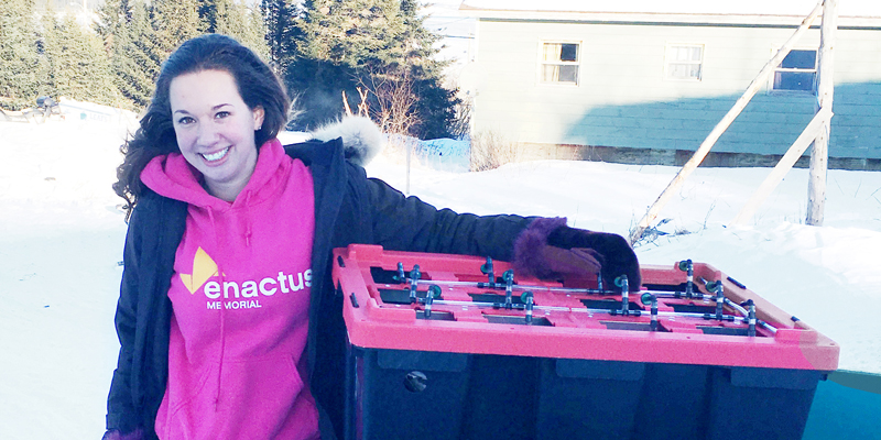 Emily Bland, president of Enactus Memorial, with a hydroponics system in Rigolet.