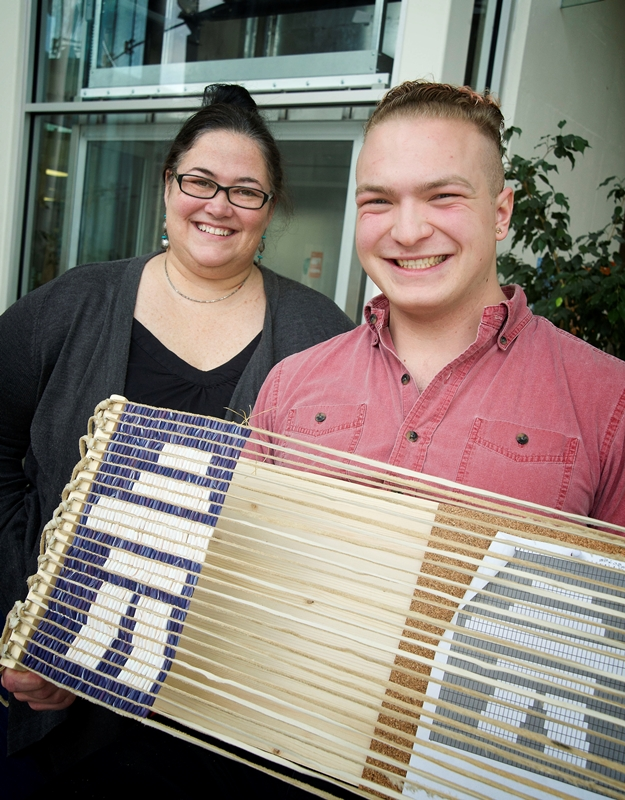From left, Kelly Anne Butler and Dennis Wass with the wampum belt.