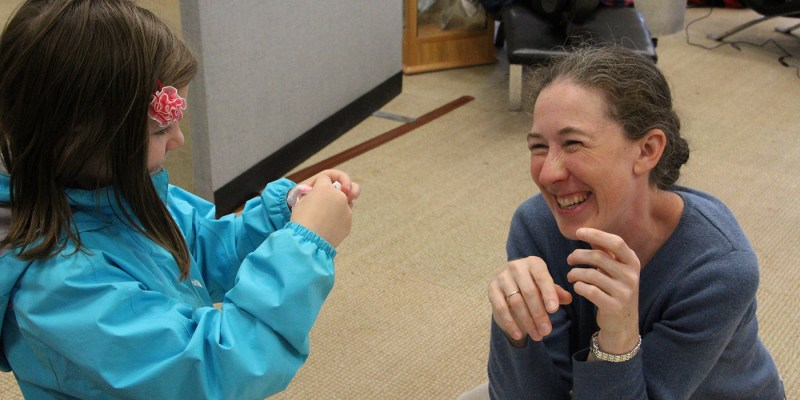 Dr. Erika Merschrod helps a young scientist make slime.