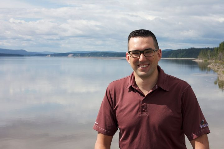 Matthew Pike in front of the Mishtashipu (Churchill) River in Happy Valley-Goose Bay.