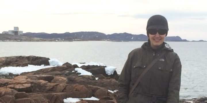 Dr. Slawinski on Fogo Island with the Fogo Island Inn in the distance.