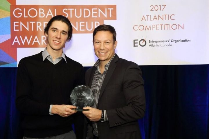 From left, Alex Henniffent receives a first place Global Student Entrepreneur Award from Ron Lovett, chair of the GSEA Atlantic Qualifiers.