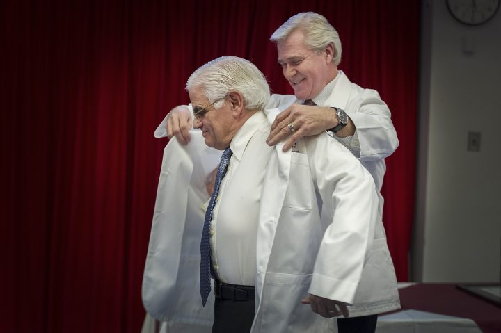From left, Don Rowe is presented with the honorary white coat by Premier Dwight Ball on Jan. 6.