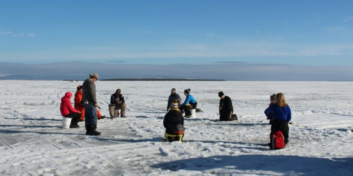 Ice fishing for smelt during a pilot program.