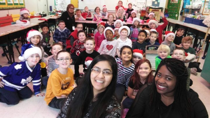 Joyce Mojimbo takes a group selfie at A.P. Low Primary School in Labrador City. Shenita Pramij, a Memorial student from Madagascar who also participated in the exchange, is also pictured.