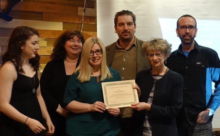 The First Year Success team celebrates their MUNSU award.