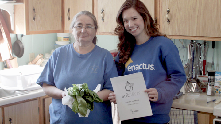 Enactus member Emily Bland poses with a Project Sucseed co-op member in Labrador.
