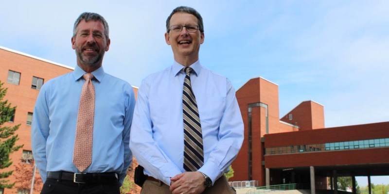 Drs. Brian Veitch and Claude Daley outside the engineering building on Memorial campus in St. John's