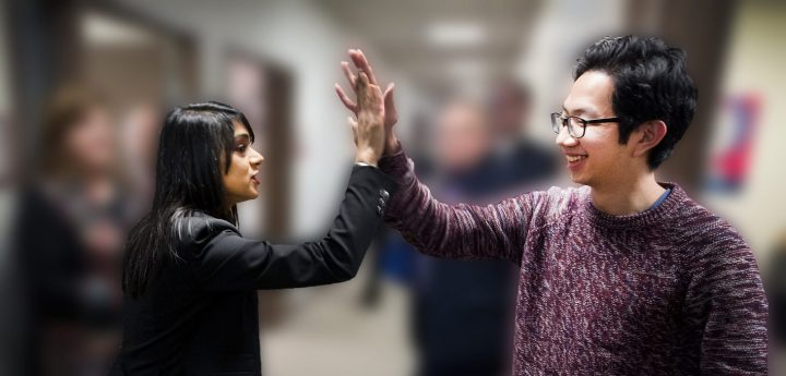 From left, Bardish Chagger, minister, of Small Business and Tourism, high fives HeyOrca founder Joe Teo at the Genesis Centre, March 2016.