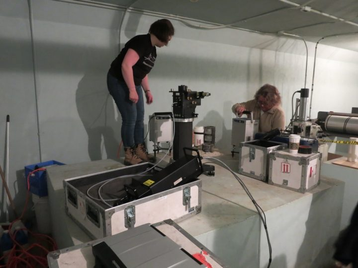 From left, Rachel van Herpt sets up the absolute gravity meter on Station 991399, which is in the centre of a concrete pillar. Alison Leitch levels the CG-5 (it likes to be upright).