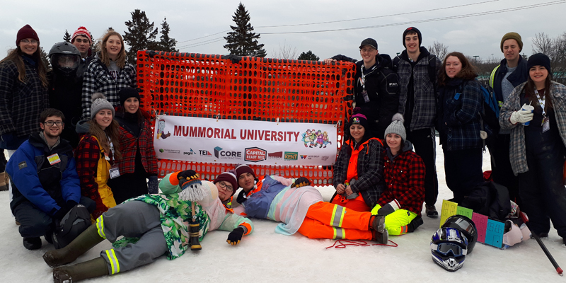 "Team MUMMorial with their sled, ""The Ugly Stick."""