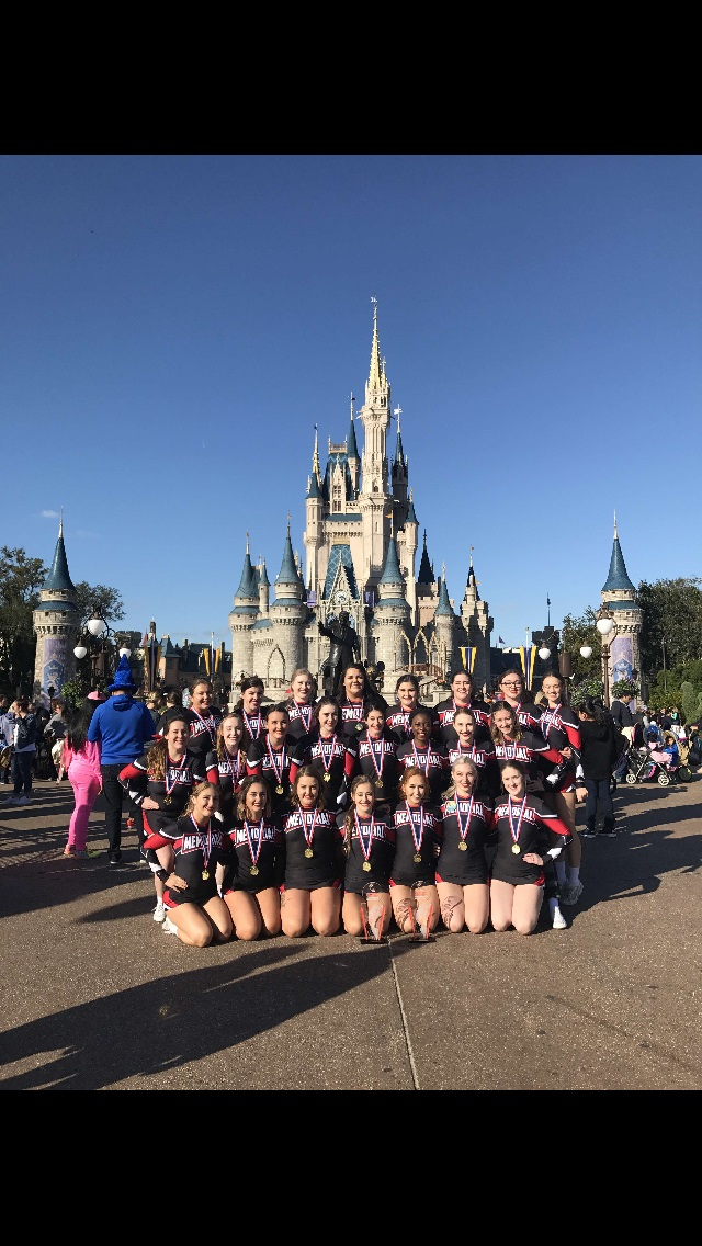 The team with their gold medals at the Walt Disney World resort.